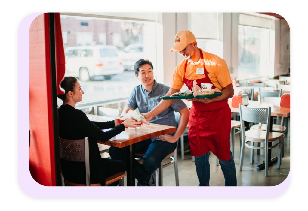 restaurant staf bringing food to table